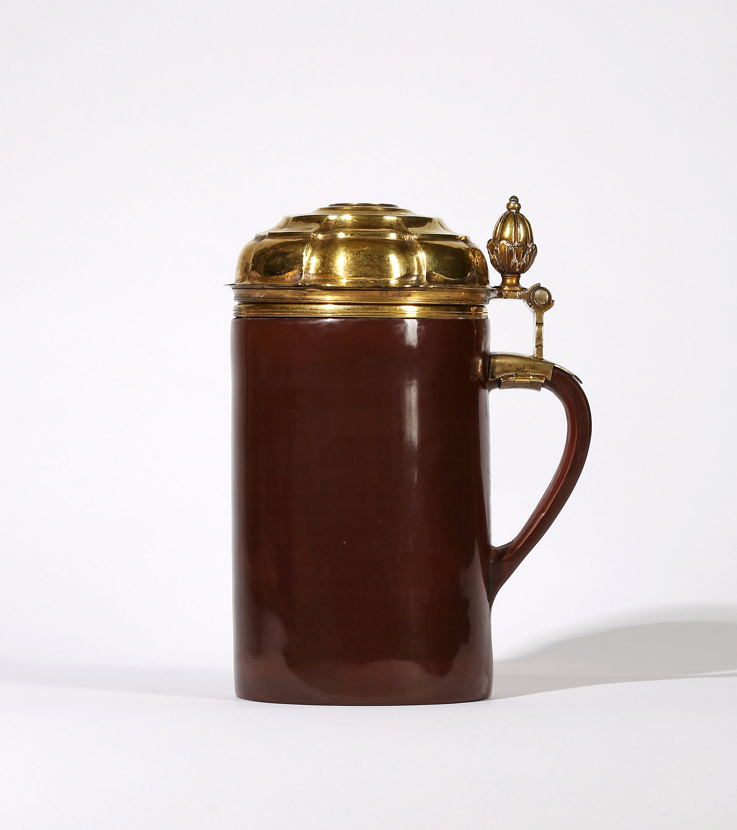 A Meissen Böttger Polished Stoneware Silver-Gilt mounted false-bottomed tankard