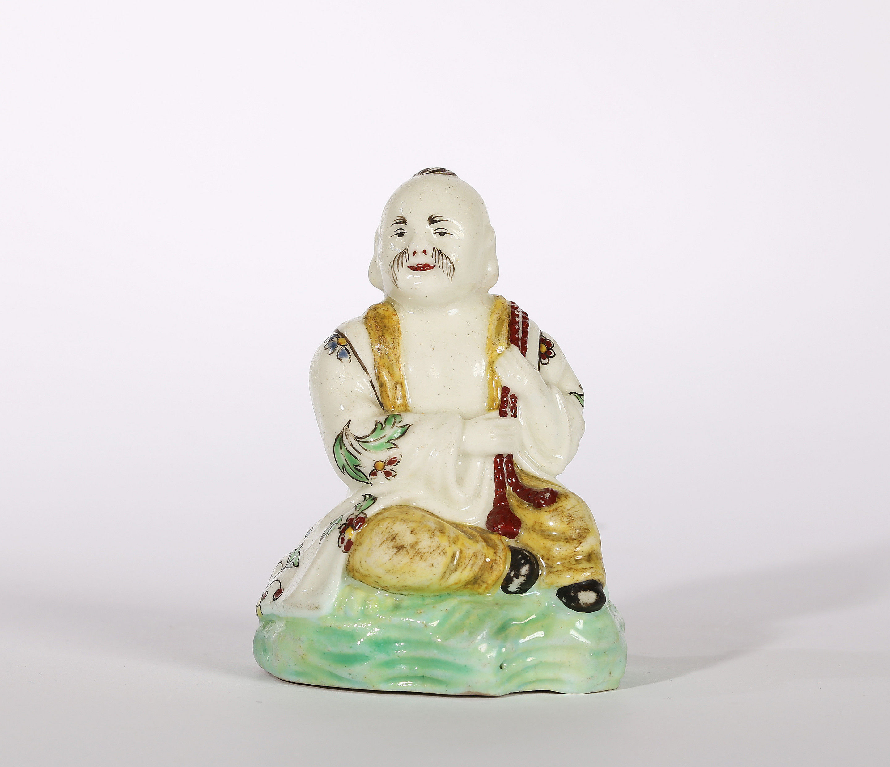 A Villeroy Figure of a Seated Chinese Man