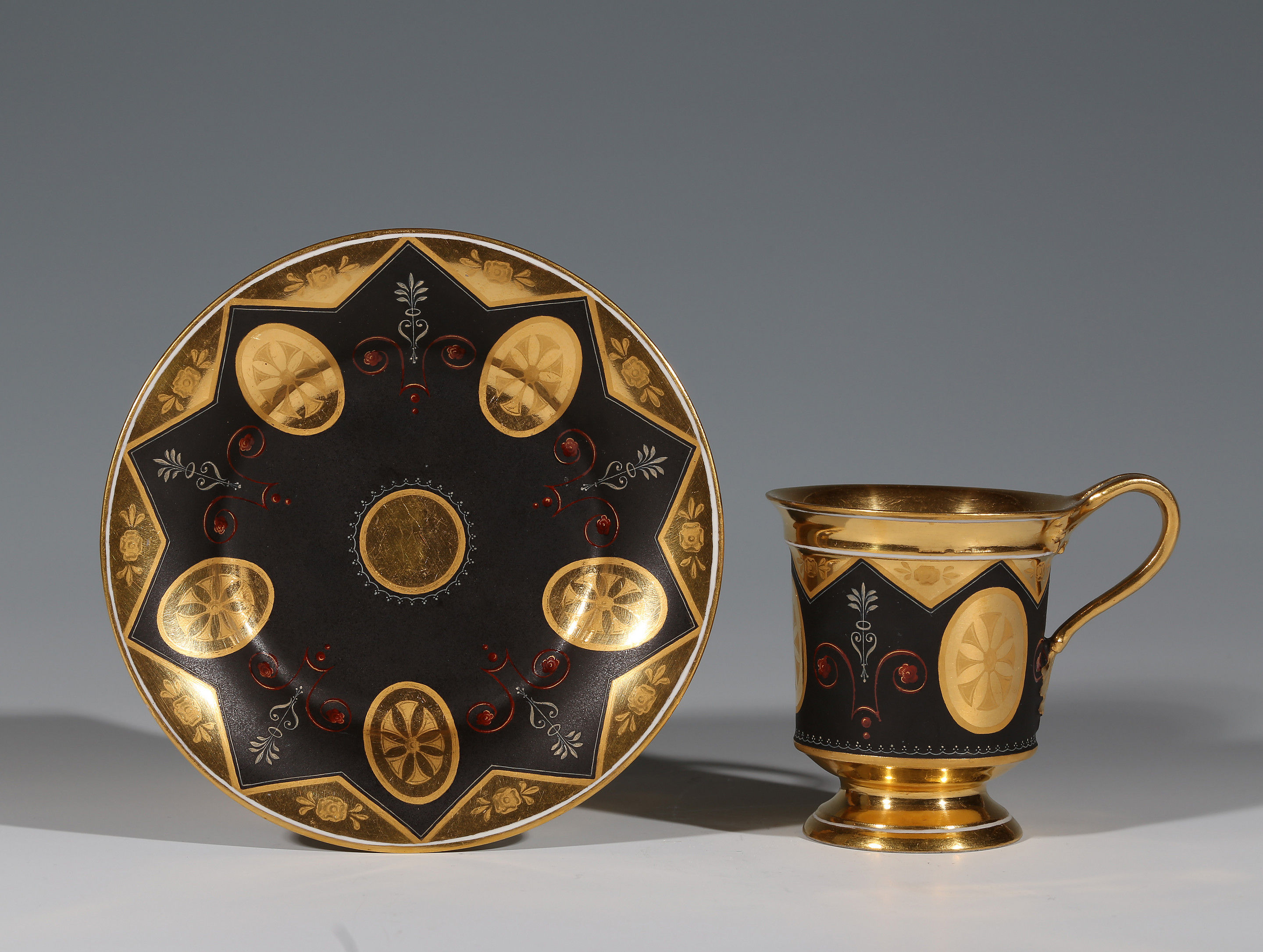 A Vienna Gold and black ground cup and saucer