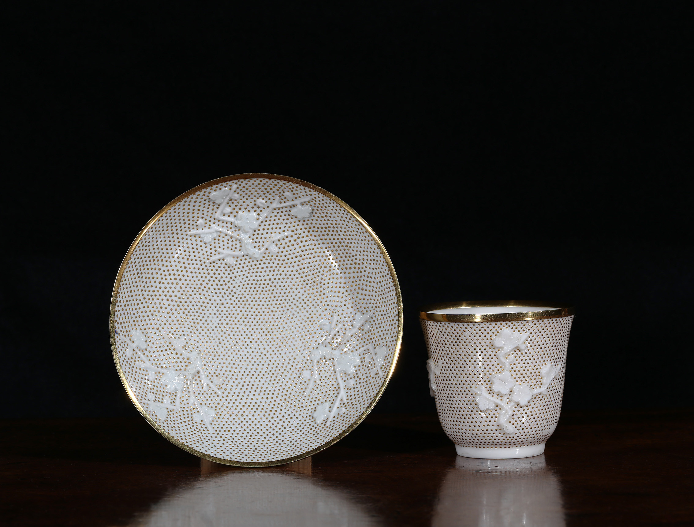 A gold-mounted Piqué d'Or Chinese Dehua beaker and Saint Cloud saucer