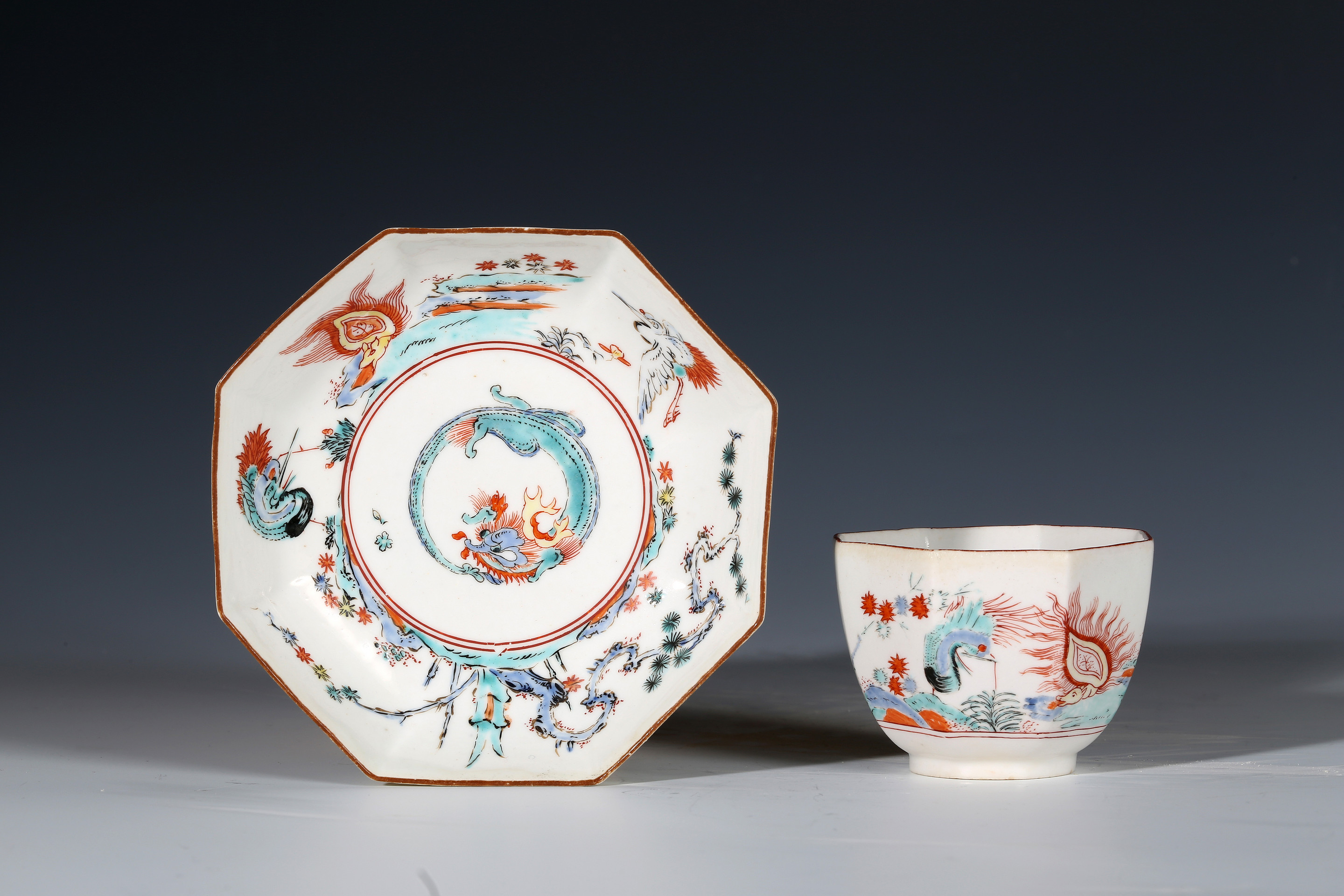 Chelsea Kakiemon Octagonal Teabowl and Saucer, With a Dragon and Flaming Tortoise