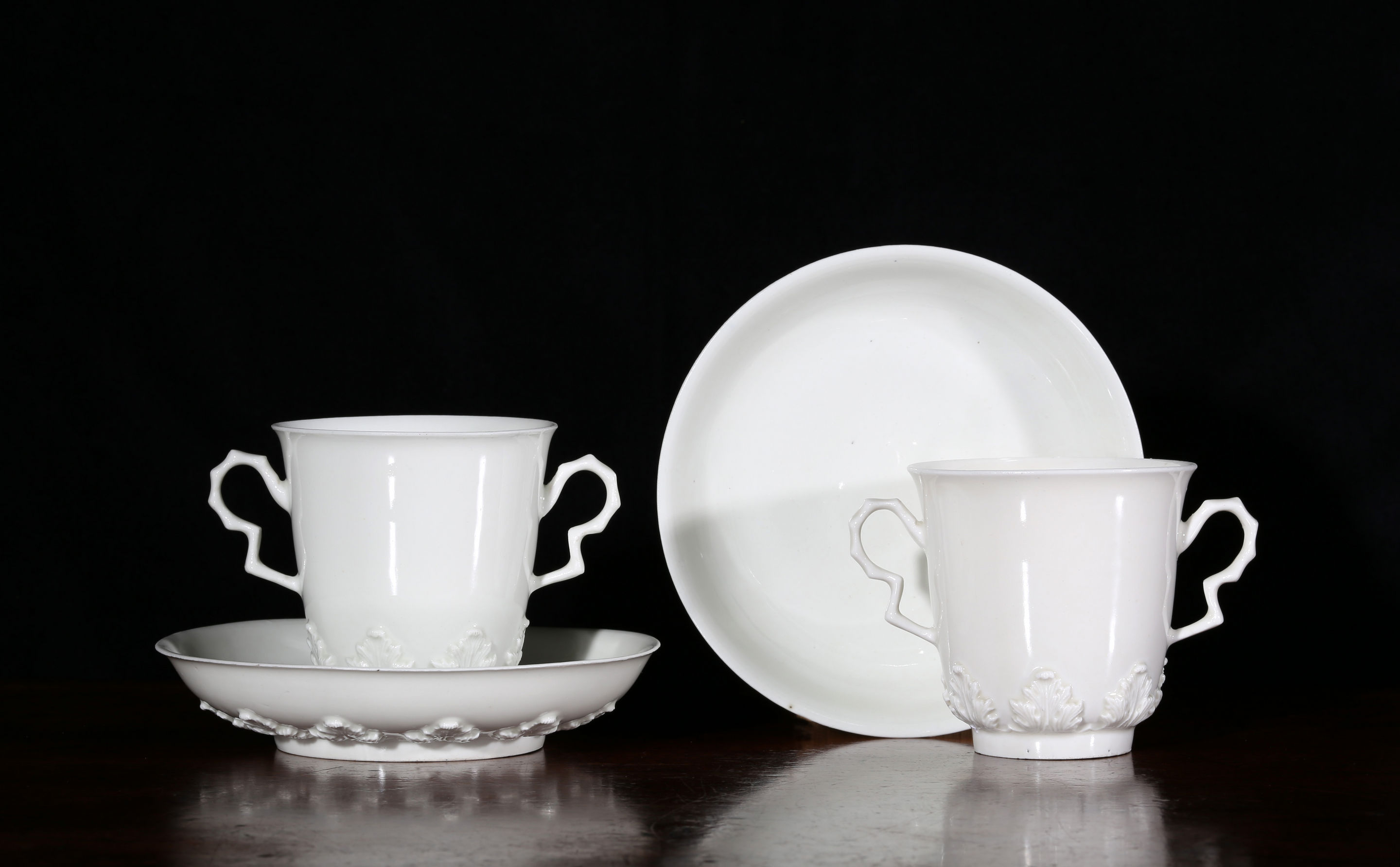 A pair of Meissen, Böttger porcelain two-handled beakers and saucers