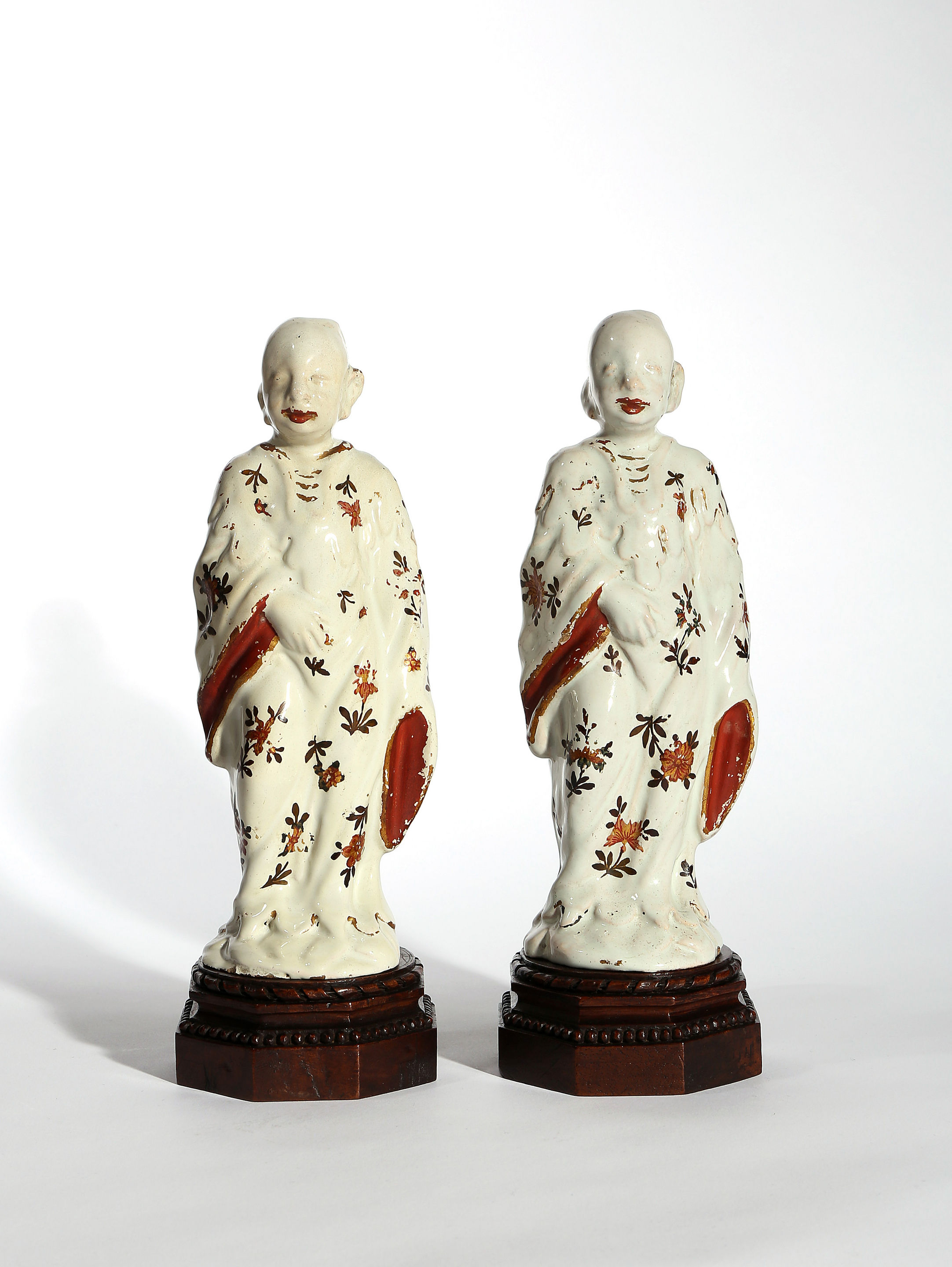 Two Milan Faience Figures of Chinamen on Wooden Stands, Factory of Felice Clerici