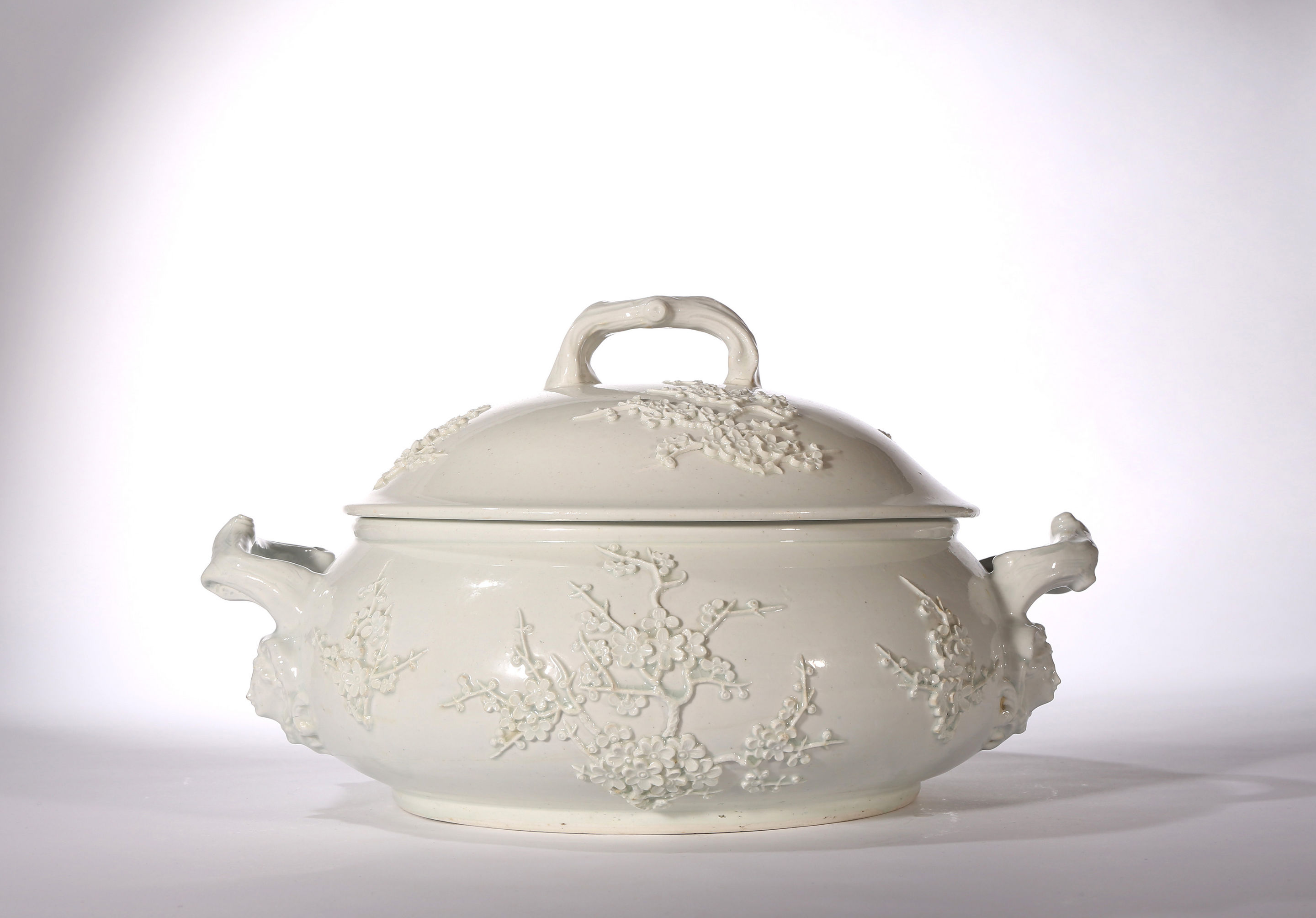 A Large Bow White Prunus Tureen and Cover
