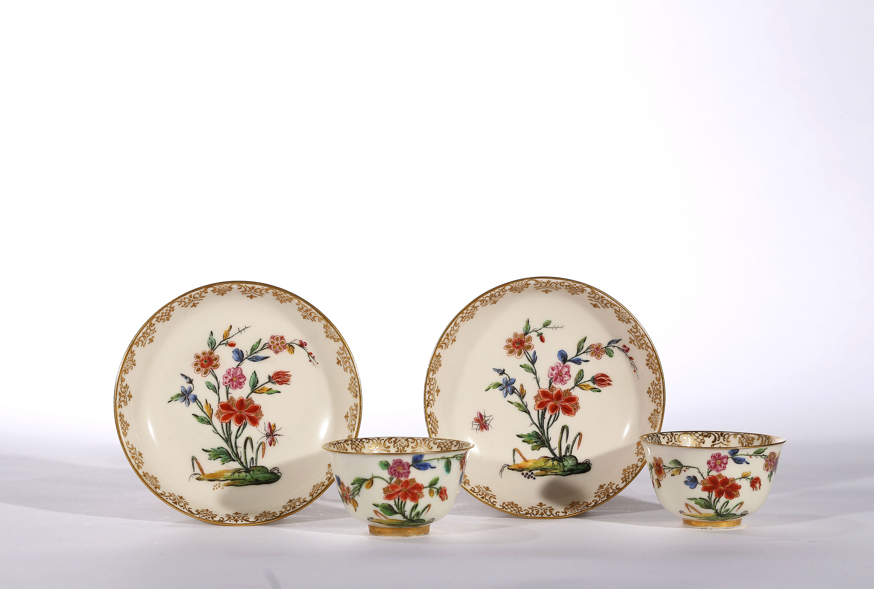 A Pair of Capodimonte Teabowls and Saucers