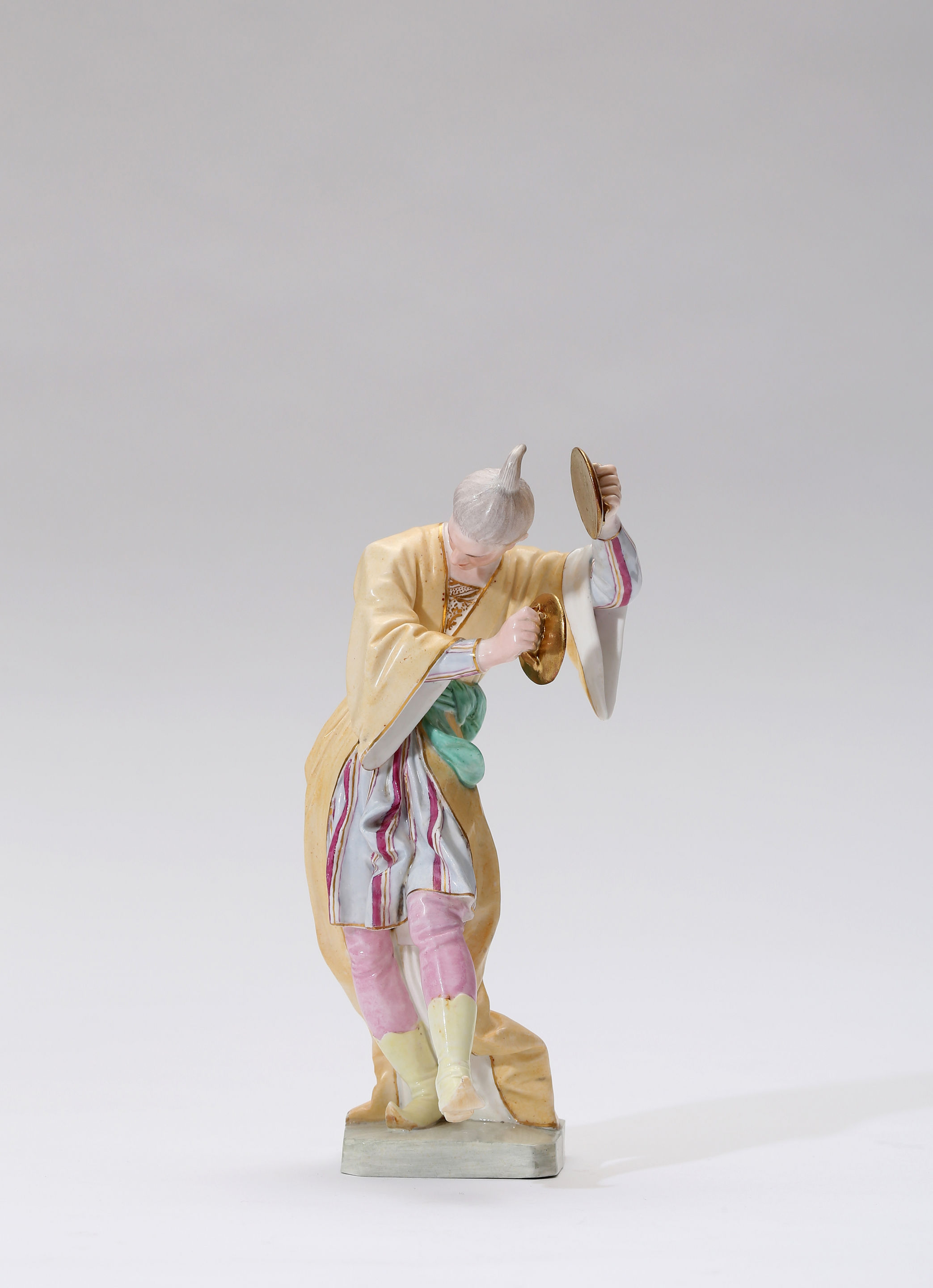 A Höchst Porcelain Figure of a Chinese Musician Playing the Cymbals, Modelled by Johann Peter Melchior