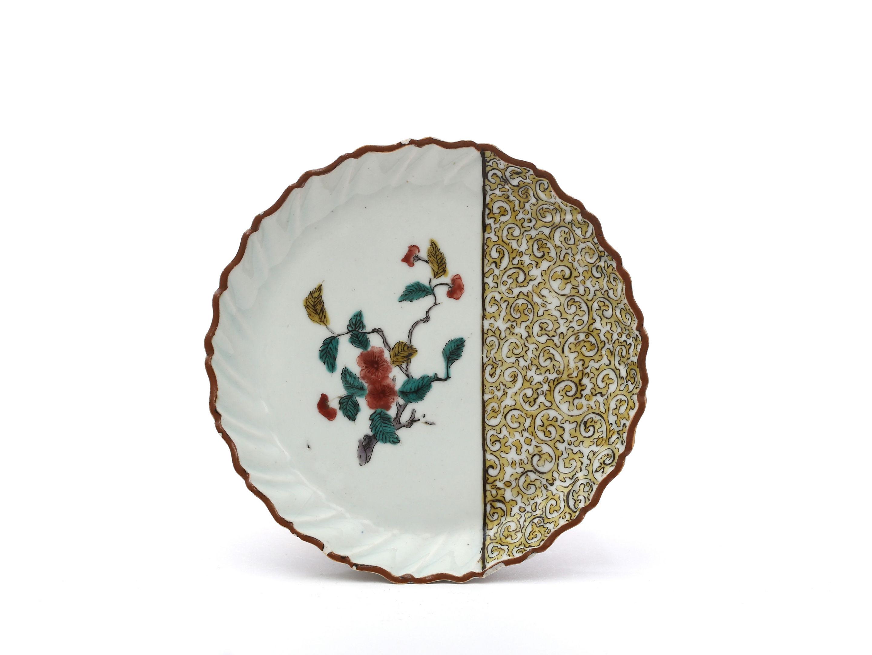 A small circular Arita-ware dish, Ko-Kutani type