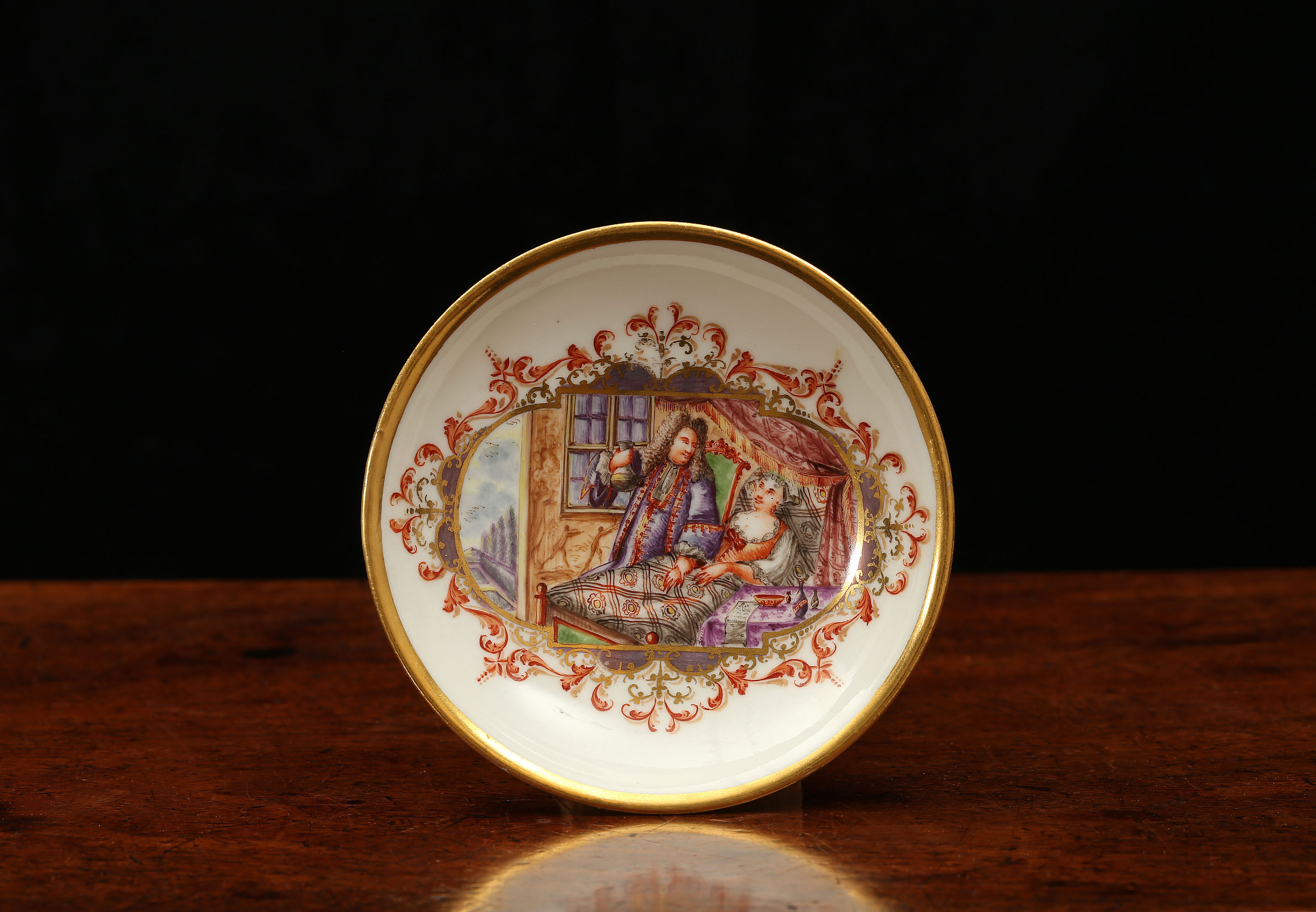 A MEISSEN SAUCER WITH A BEDSIDE SCENE, Probably painted by Johann Gregorius Höroldt