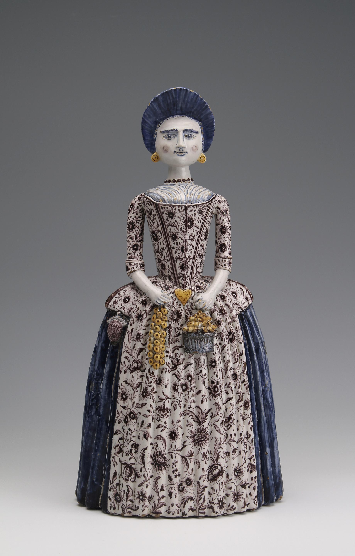 A pottery figure of a Frisian lady