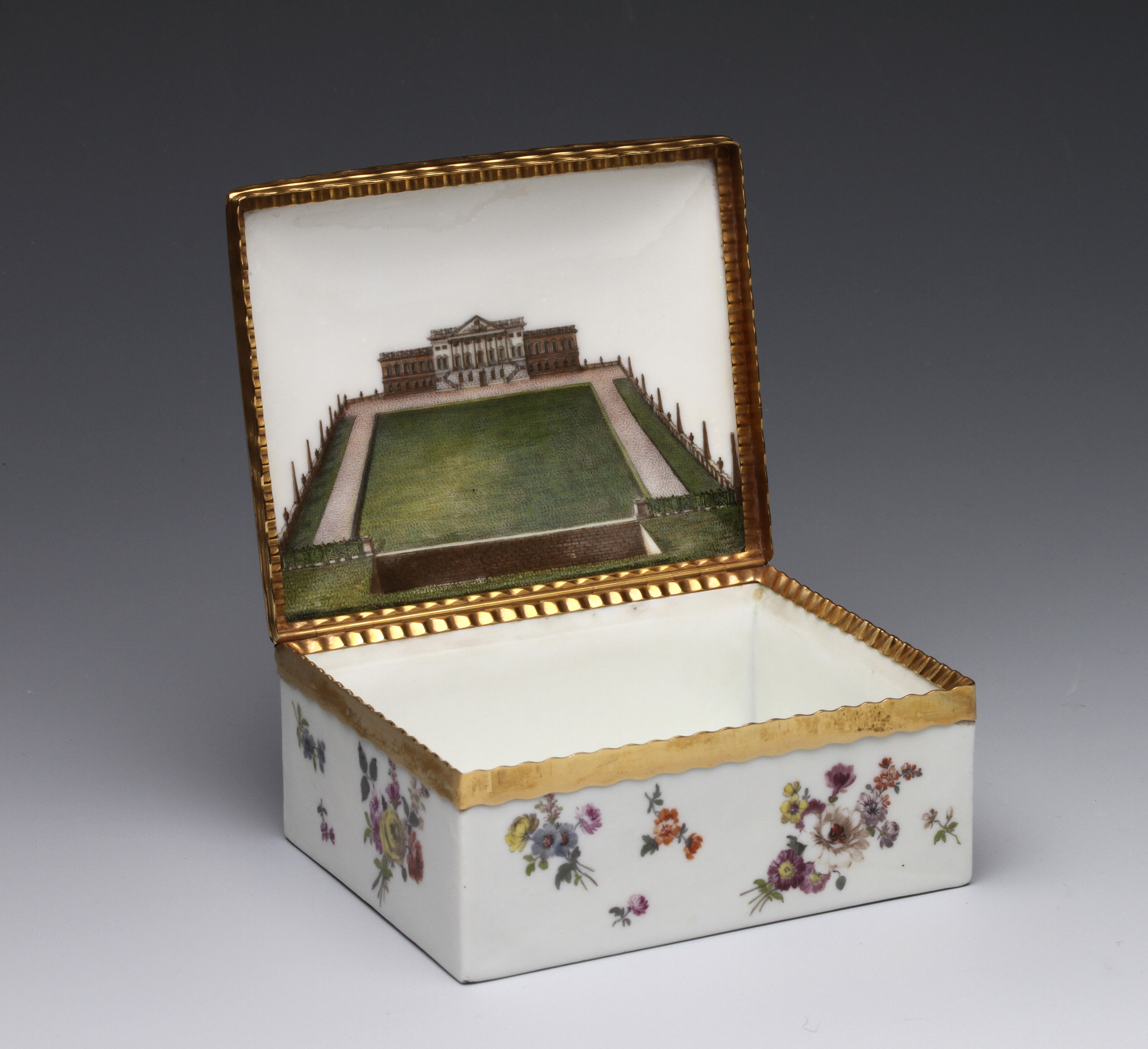A Meissen gold-mounted table snuff box painted with a view of Wanstead House