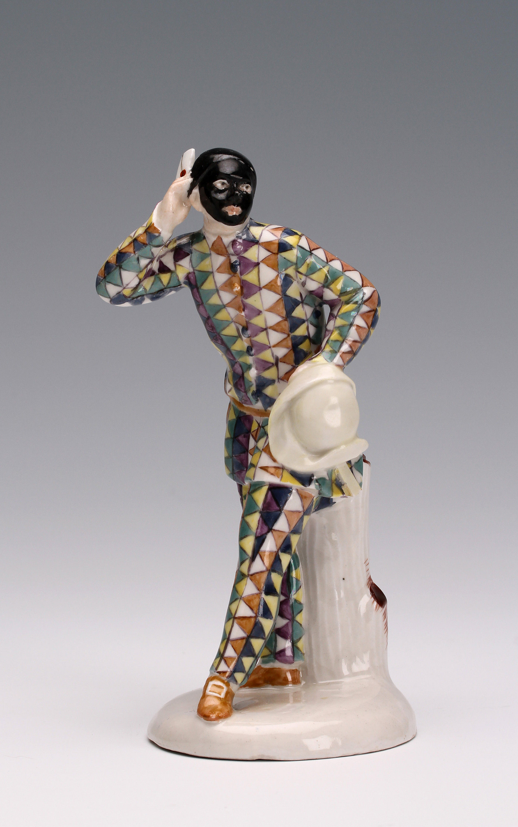 A Closter Veilsdorf figure of Harlequin modelled by Wenzel Neu