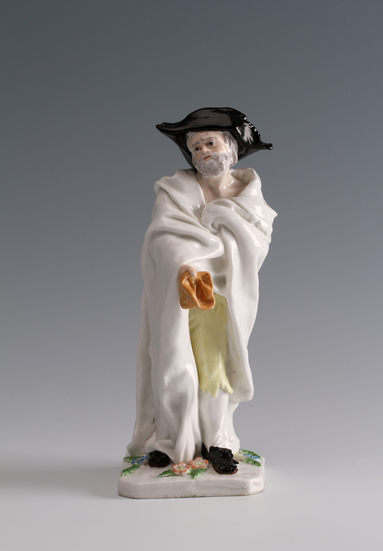A Chelsea figure of an 'Italian Beggar' modelled by Joseph Willems