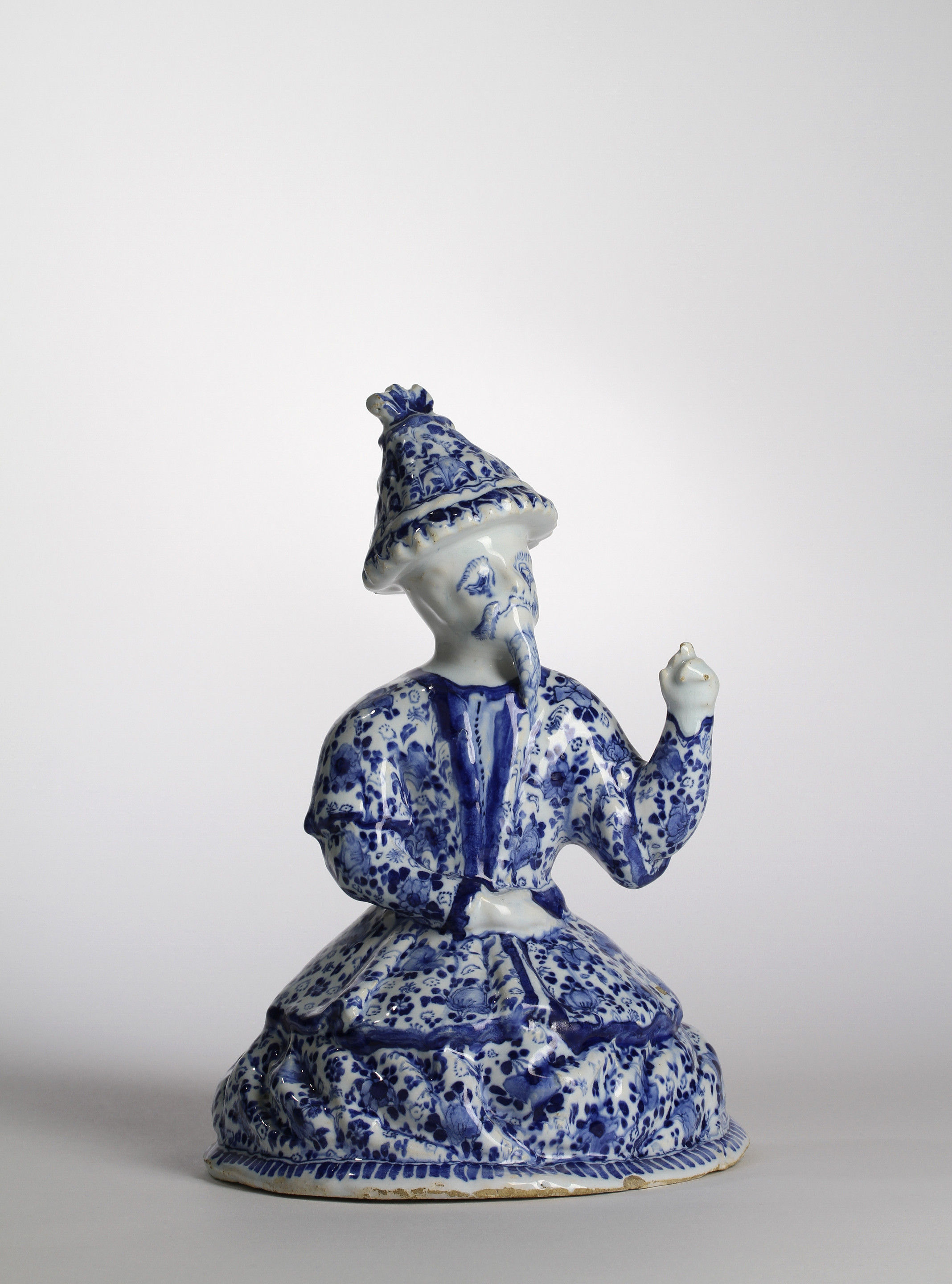 A BERLIN BLUE AND WHITE FAIENCE FIGURE OF A CHINAMAN Gerhard Wolbeer's Factory