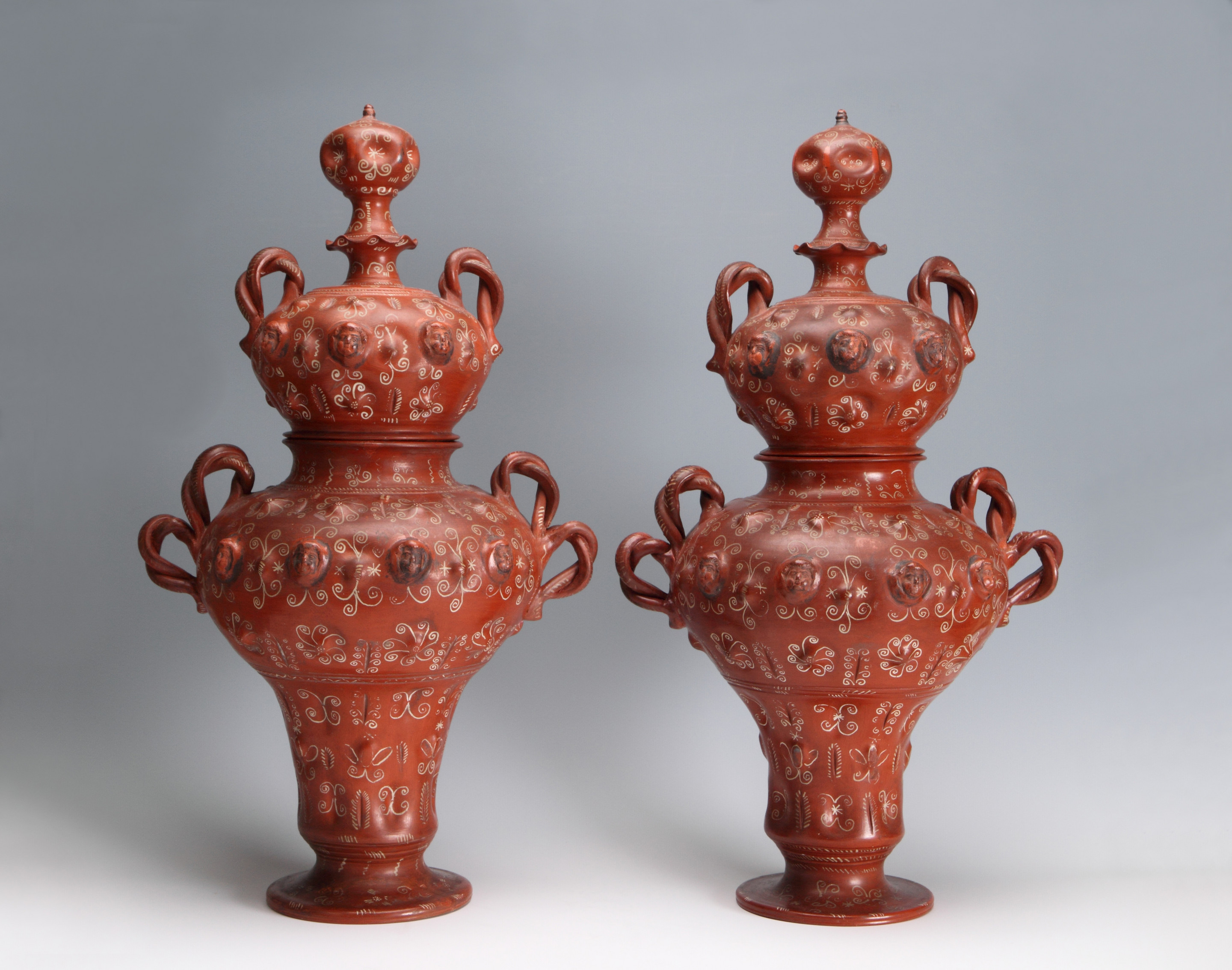 A Pair of Mexican Burnished and Slip-Decorated Vases and Covers, Tonalá, Mexico